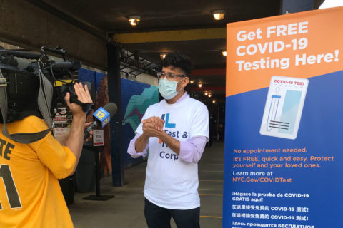 Neil Vora talks to local news during an event to promote testing for COVID-19 in New York City. (Photo/Courtesy of Neil Vora)