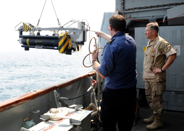 Vice Adm. Mark Fox, right, then commander of U.S. Naval Forces Central Command and Combined Maritime Forces, watches as the crew of the British Royal Navy Hunt-class mine countermeasures vessel HMS Chittingfold (M37) lowers Sea Fox, a mine neutralizer vehicle, into the water in 2010. U.S. Navy photo.