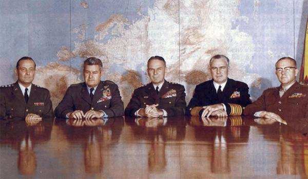 On 1 October, the President appointed Army General Maxwell Taylor, center, to take over for General Lyman Lemnitzer as chairman of the Joint Chiefs of Staff. Taylor had been serving in the White House as military representative to the President. Flanking Taylor, left to right, are Army Chief of Staff General Earle Wheeler, Air Force Chief of Staff General Curtis LeMay, Chief of Naval Operations Admiral George Anderson, and Commandant of the Marine Corps General David Shoup. Navy History and Hertigae Command