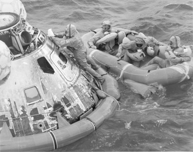 Decontaminating the Apollo 11 command module as the astronauts wait to be recovered, July 24, 1969. US Naval Institute Archives