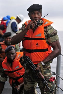 Cameroon navy Lt. j.g. Yves Itondo during Exercise Obangame Express. The exercise is an at-sea maritime exercise designed to improve cooperation among participating nations to promote maritime safety and security in the Gulf of Guinea.