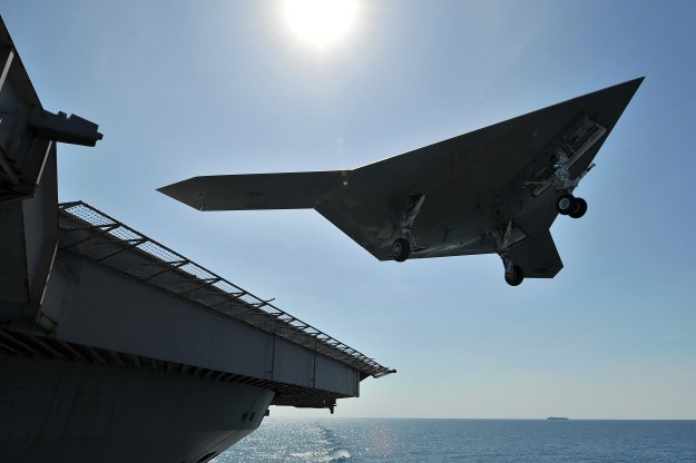 An X-47B Unmanned Combat Air System (UCAS) demonstrator conducts a touch and go landing on the flight deck of the aircraft carrier USS George H.W. Bush (CVN-77). US Navy Photo