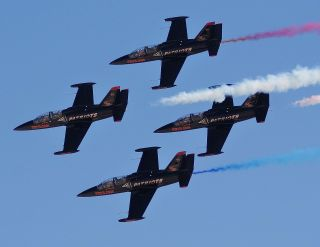 The Patriots Jet Team fly Aero L-39 Albatros jets during a 2009 show at Nellis Air Force Base, Nev. Teams like The Patriots are in demand following cancellations by Pentagon jet teams.