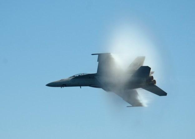 An F/A-18F Super Hornet flies from USS Dwight D. Eisenhower (CVN-69). US Navy Photo.