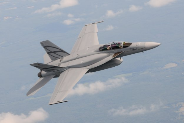First flight of the F/A-18E/F Advanced Super Hornet with conformal fuel tanks and Enclosed Weapons Pod. Boeing Photo