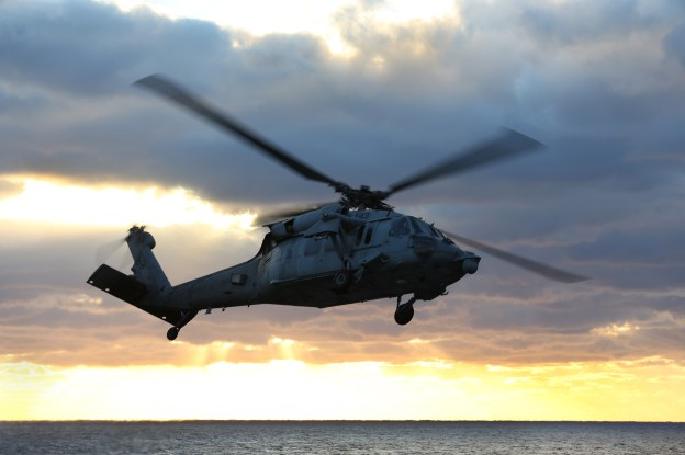 MH-60S Knighthawk from Helicopter Sea Combat Squadron 28 departs the flight deck of the amphibious assault ship USS Kearsarge (LHD-3) in January.