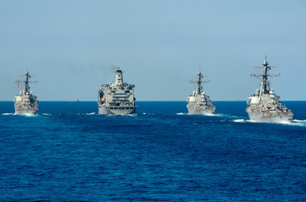 Arleigh Burke-class guided-missile destroyers USS Ramage (DDG-61), USS Barry (DDG-52) and USS Stout (DDG-55) conduct a replenishment-at-sea with the Military Sealift Command oiler USNS Leroy Grumman (T-AO-195) on Sept. 27. US Navy Photo