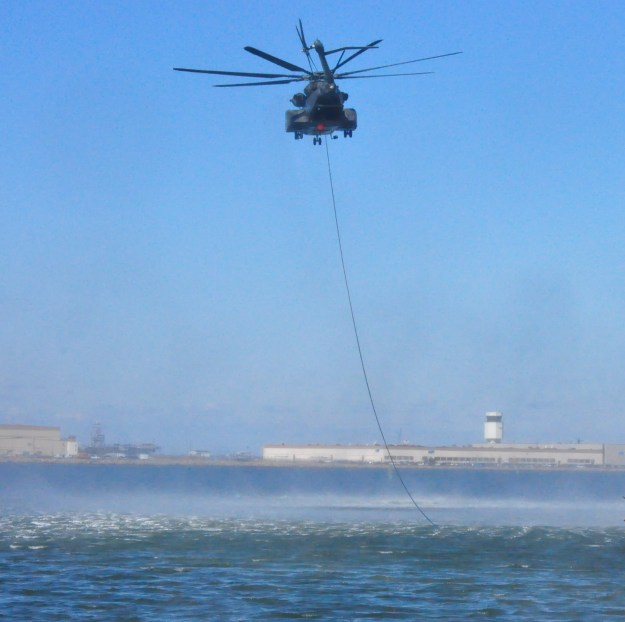 MH-53E Sea Dragon helicopter assigned to Helicopter Mine Countermeasures Squadron (HM) 14 conducts practice MK-105 mine countermeasure operations in the Chesapeake Bay in 2011. US Navy Photo
