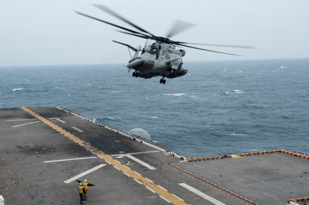 A CH-53 Super Stallion helicopter takes off from the flight deck of the amphibious assault ship USS Bonhomme Richard (LHD-6). US Navy Photo