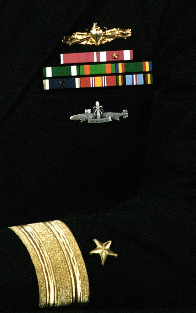 Rear Admiral (lower half) Robert E. Traister, USN (covered)