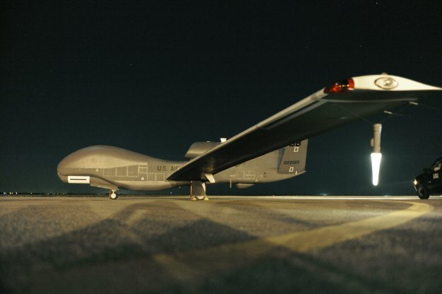 RQ-4 Global Hawk sits on the runway before beginning a nighttime mission. US Air Force Photo
