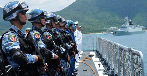 Members of a special battle force stand on China's missile destroyer Haikou at a naval port in Sanya, south China's Hainan Province, June 9, 2014. Xinhua Photo