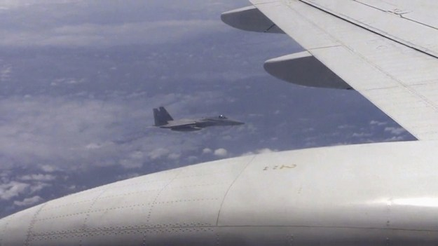 A Japanese F-15J allegedly buzzing a Chinese Tu-154 on Wednesday.