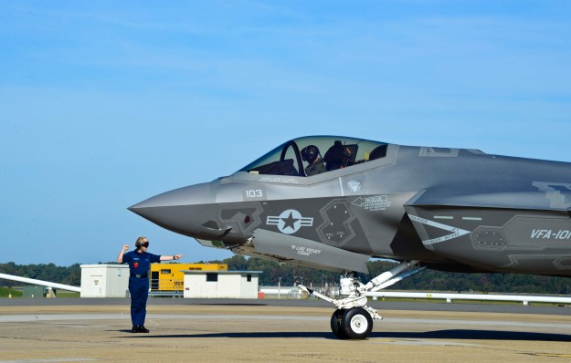 Lt. Scott Cleveland, assigned to Strike Fighter Squadron (VFA) 101, is directed to park the F-35C Lightning II Joint Strike Fighter after landing at Naval Air Station Oceana. US Navy Photo