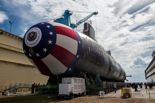 The Virginia-class attack submarine Pre-commissioning unit John Warner (SSN 785) is moved to Newport News Shipbuilding's floating dry dock on Sept. 1, 2014. Huntington Ingalls Industries photo.