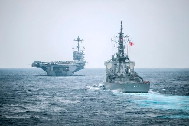 USS George Washington (CVN-73) with the Japan Maritime Self-Defense Force Kongou-class guided-missile destroyer JS Kirishima (DDG-174) on Nov. 18, 2014. US Navy Photo