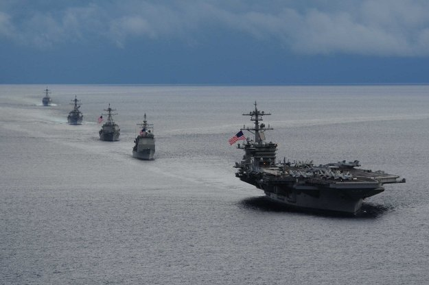 USS Theodore Roosevelt (CVN-71) leads a formation of ships from Carrier Strike Group (CSG) 12 during a maneuvering exercise on Sept. 23, 2014. US Navy Photo