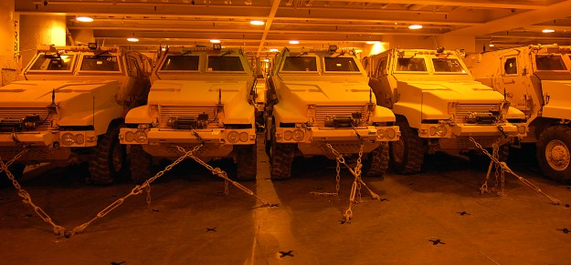 Mine resistant ambush protected vehicles (MRAP) are offloaded from the Military Sealift Command roll-on/roll-off ship USNS Pililaau (T-AKR 304) onto the pier in 2008. US Navy Photo