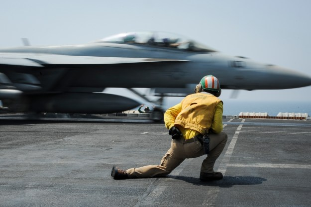 Lt. Cmdr. Craig Ryan launches an F/A-18F Super Hornet assigned to the Red Rippers of Strike Fighter Squadron (VFA) 11 from the flight deck of the aircraft carrier USS Theodore Roosevelt (CVN-71) on Aug. 27, 2015. US Navy