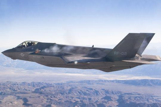 """F-35 test pilot Maj Charles """"Flak"""" Trickey fired the GAU-22/A 25mm gun from F-35A aircraft AF-2 in the first aerial gun test operating on the China Lake, California, test range, Oct. 30, 2015. US Air Force photo."""