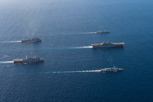 The Boxer Amphibious Ready Group (ARG), composed of amphibious assault ship USS Boxer (LHD 4), amphibious transport dock ship USS New Orleans (LPD 18), dock landing ship USS Harpers Ferry (LSD 49) along with HMCS Vancouver (FF 331) and HMCS Calgary (FF 335) steam in formation on Nov. 5, 2015. US Navy photo.