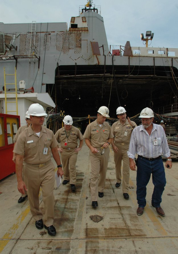 Chief of Naval Operations Adm. Mike Mullen, center, listens to Cmdr. Brad Skillman, the prospective Commanding Officer of Pre-Commissioning Unit New Orleans (LPD-18 ) in 2005. US Navy