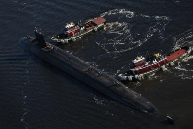 The Ohio-class ballistic-missile submarine USS West Virginia (SSBN 736) departs Norfolk Naval Shipyard in Portsmouth, Va. following an engineering refueling overhaul on Oct. 24, 2013. US Navy photo.