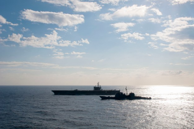 USS Antietam (CG-54), right, steams alongside USS Ronald Reagan (CVN-76). US Navy Photo