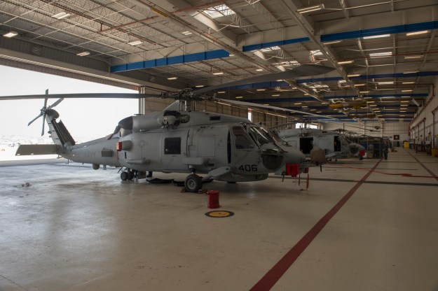 MH-60R Sea Hawk helicopters assigned to the Maritime Strike Squadron (HSM) 41 are parked on the flight line at Naval Air Station North Island. The Navy has spent its limited military construction funds on forward-located bases and training and maintenance facilities for new aircraft models, leaving little funding for maintaining and improving administrative and residential buildings. US Navy photo.