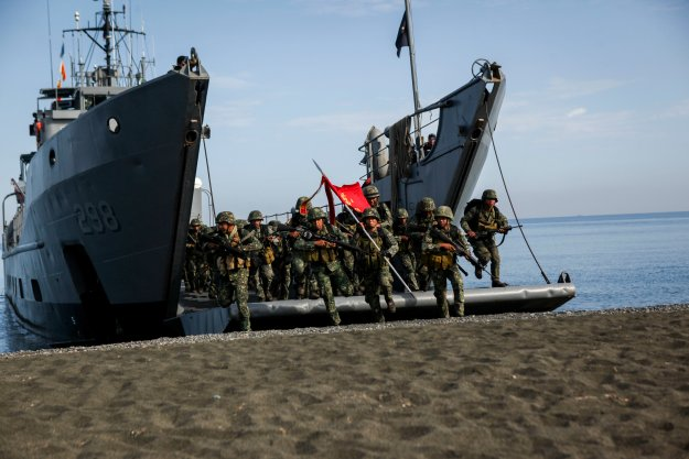 Philippine marines with the Joint Rapid Reaction Force (JRRF), conduct an amphibious landing utilizing Philippine logistical navy ships to seize a scenario-based objective as part of Exercise Balikatan 2016. US Marine Corps Photo