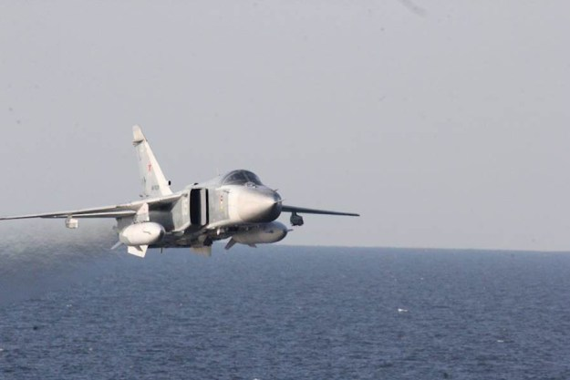 A Russian Sukhoi Su-24 attack aircraft makes a low altitude pass by the USS Donald Cook (DDG-75) April 12, 2016. US Navy Photo