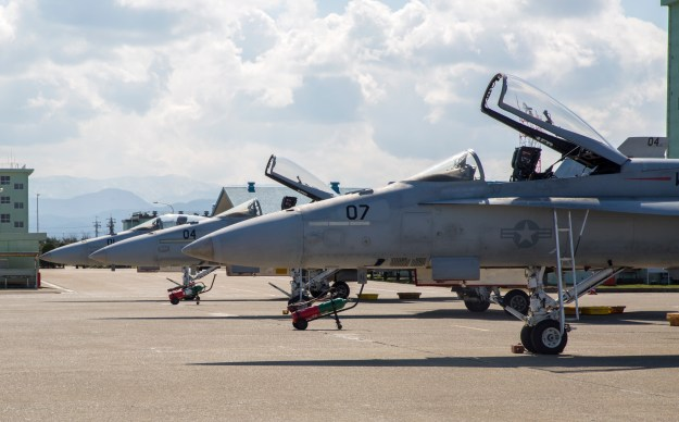 FA-18A++ Hornets with Marine Fighter Attack Squadron(VMFA) 314, forward based at Marine Corps Air Station Iwakuni, Japan, are lined up on the flightline at Komatsu Air Base, Japan, during the Komatsu Aviation Training Relocation exercise March 7-18, 2016. US Marine Corps photo.