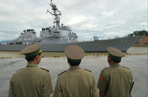 Vietnamese military officials watch as USS Curtis Wilbur (DDG-54) prepares to moor in the Vietnamese port of Da Nang. US Navy Photo