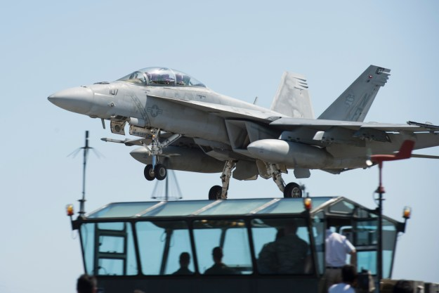 An F/A-18E Super Hornet, attached to the Diamondbacks of Strike Fighter Squadron (VFA) 102, assigned to Carrier Air Wing (CVW) 5, practices a touch-and-go landing on May 11, 2016. US Navy Photo