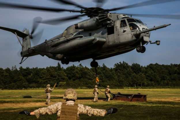 A Marine guides a CH-53 Super Stallion during a helicopter support team exercise at Landing Zone Albatross aboard Camp Lejeune, N.C., Sept. 2, 2015. US Marine Corps photo.