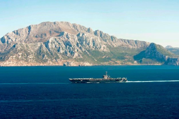 The aircraft carrier USS Dwight D. Eisenhower (CVN 69) transits through the Strait of Gibraltar into the Mediterranean Sea on June 13, 2016. US Navy photo.