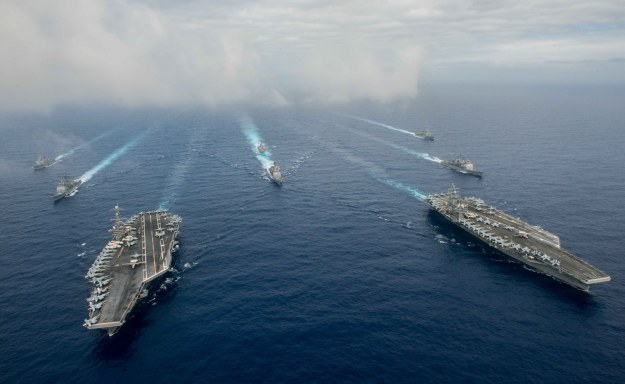 The Nimitz-class aircraft carriers USS John C. Stennis (CVN 74), left, and USS Ronald Reagan (CVN 76) conduct dual aircraft carrier strike group operations in the U.S. 7th Fleet area of operations in support of security and stability in the Indo-Asia-Pacific. US Navy photo.