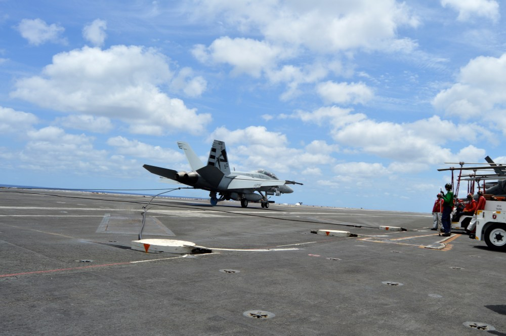 medium resolution of a f a 18f super hornet catches the arresting gear wire while landing aboard uss