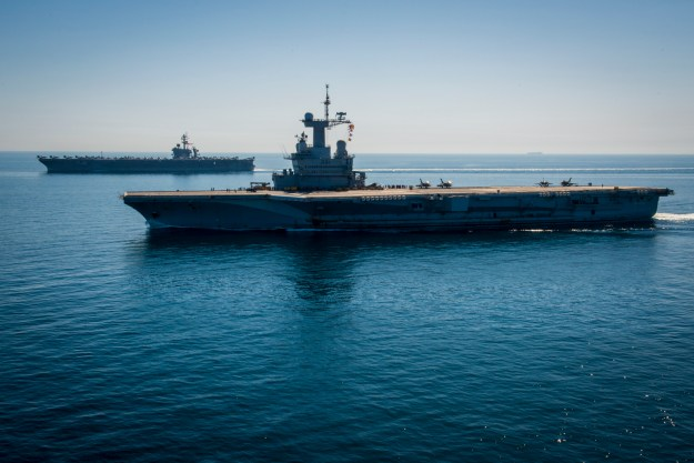 USS Carl Vinson (CVN 70), left, and the French nuclear aircraft carrier Charles de Gaulle (R91) transit the Northern Arabian Gulf in 2015. US Navy Photo