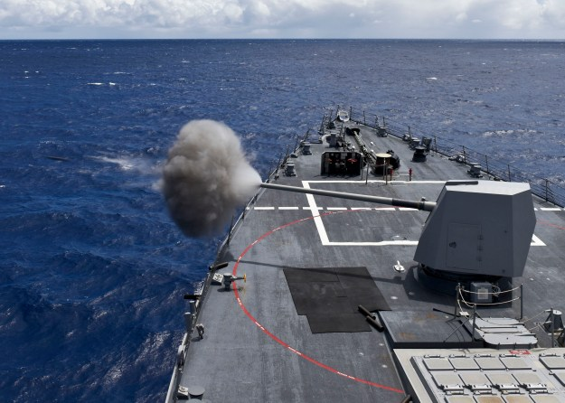 USS Shoup (DDG 86) fires a MK 45 5-inch gun during a live fire exercise during Rim of the Pacific 2016. US Navy Photo