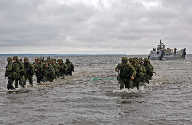 Estonian soldiers wade ashore during a combined U.S. and Estonia amphibious assault training exercise during Baltic Operations (BALTOPS) 2010. US Navy Photo