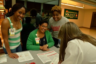 Debra Clark signs up at the Bone Marrow Donor Drive, as UTHSC Nursing students Etoshia Butler, Jennifer McClennon and Porshia Mahoro look on. The drive was sponsored by the UTHSC College of Nursing as one of the Student Philanthropy Week activities.