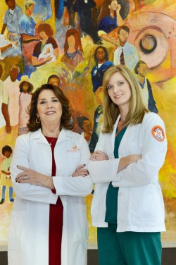Irma Jordan, DNP (left), assistant professor in the University of Tennessee Health Science Center College of Nursing, will have the pleasure of presenting her daughter, Lisa Dawson, with her Bachelor of Science in Nursing degree at the Dec. 12 UTHSC commencement ceremony. The two enjoy a short break in front of a mural at Methodist South Hospital, where Lisa is completing her clinical training.