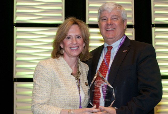 Dr. Michael Carter receives the National Organization of Nurse Practitioner Faculties 2015 Lifetime Achievement Award from Sheila Melander, PhD, RN, ACNP-BC, FCCM, FAANP, the organization's president and a former UTHSC professor.