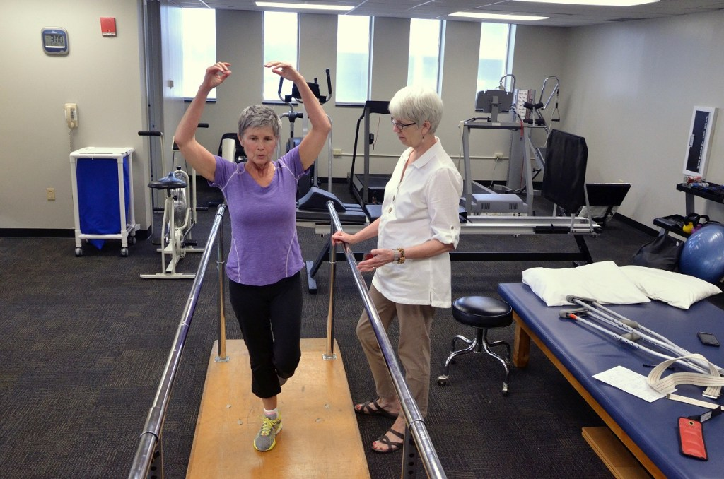 Ann Coleman works with D. McLendon in the bright new University Therapists location on campus.