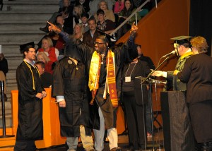 A student rejoices as he walks across the stage.