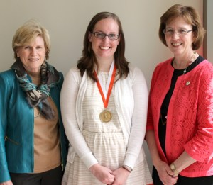 From left: Susan Benner, associate dean of the College of Education, Health and Human Sciences; Brooke Terry, graduating senior and 2014 Claxton Medal winner; and Theresa Lee, dean of the College of Arts and Sciences