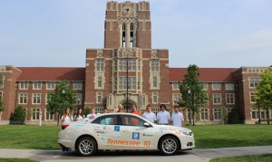 Members of UT's EcoCAR 2 team—made up of students and faculty from the College of Engineering, College of Communication and Information, and College of Business Administration—gather with the vehicle in front of Ayres Hall for its official sendoff to the national competition.