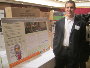 """Vic Lollar stands with his EUReCA-winning poster """"In-Situ Condition Monitoring of Components in Small Modular Reactors"""" in March."""