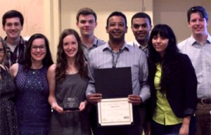 ChemE car team members receive a plaque and certificate for placing third in the regional competition. Team members, from left, include Christopher Neal, Mary McBride, Melanie Lindsey, Matthew Sodl, faculty advisor Gabriel Goenaga, Christian Wilson, Samantha Medina, and Aston Thompson.